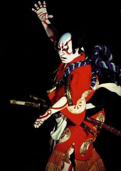 Japanese Kabuki Theatre - I like the use of black as the background, creating drama, and also highlighting the colours of the Kabuki costume.
