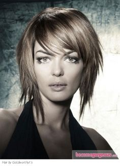whispy layered medium bob with whispy bangs ( I like this with out the long pieces in front, cut at the chin would be cute.