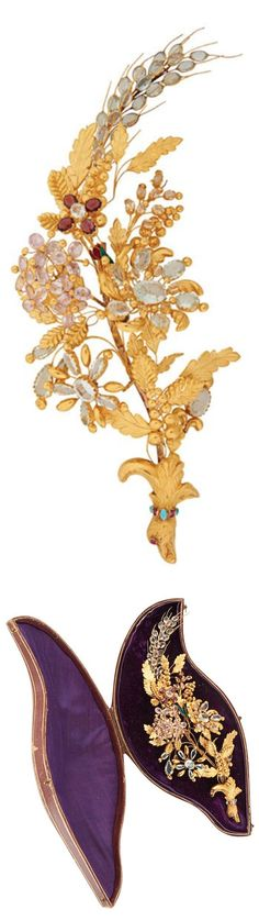 LATE GEORGIAN JEWELED GOLD HAIR ORNAMENT IN CASE, Designed as a floral and wheat spray in bird headed posy holder. En tremblant blossoms set with aquamarines, pink and yellow topaz and enamel, steel aigrette pin. Probably Vienna, ca. 1820. 18k, unmarked.