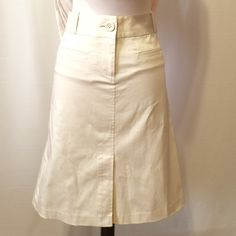 """Zara Cream Stretch A-line Skirt Classic skirt in stretch cotton. 2"""" contour waistband with belt loops. Front fly zipper with front kick pleat, functional welt front pockets, back darts. 97% cotton 3% spandex Machine washable 36"""" hips 23"""" overall length Never worn Zara Skirts Midi"""