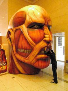 "Balloon modeled after the head of the giant 50 m super height that appeared in the ""Attack on Titan"". To celebrate the big hit, was open to the public on the first floor entrance Kodansha headquarters in June. 「進撃の巨人」に登場する身長50メートル超の巨人の頭部を模した風船。大ヒットを記念し、6月に講談社本社1階入り口で一般公開した"