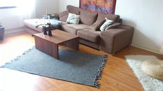 IKEA HACK.. from throw blanket to area rug by sewing it to nonslip .. love it
