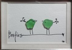 Besties - an original design of two whimsical birds made from genuine sea glass standing on top of a hand lettered word. This piece is a fun way to celebrate best friends!! Besties is in a 3 3/4 x 4 3/4 silver table top frame. It is one in a series of whimsical birds perched on hand lettered words such as: love, joy, peace, simplify, thrive, hope, believe, dream, friend, enjoy, love you, love you Mom, and your choice word or name. You also have a choice in the frame color: black, wh...