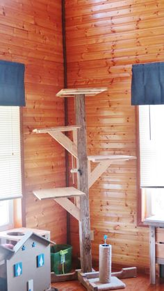 My cat tree made from 4x4 and pallet wood.