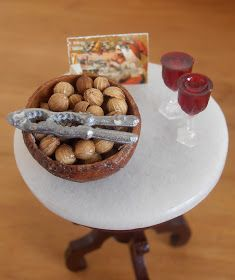 A miniature bowl of nuts When I was a girl, we always had a wooden bowl of nuts in the shell and a nutcracker on the table at Christmas...