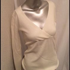 """Women's White V Neck Sweater. Women's White V Neck Sweater by Tapemeasure. 54% Cotton, 27% Lyocell, 19% Nylon. Machine Wash Warm. Armpit to armpit 16.5"""", Length of sweater 24.5, Sleeve Length 24"""", V Neck 10"""". This is a large, but a petite large. Never Been Worn. Please note the measurements described. Tapemeasure Sweaters V-Necks"""