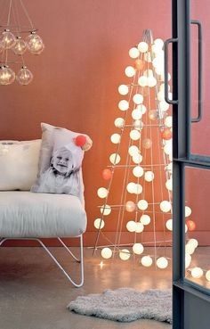 Stylish Alternatives to the Traditional Christmas Tree- wire frame and globe lights