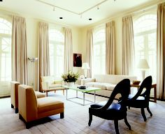 Stunning neutral living room with pinch pleat drapery!