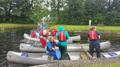 Me having a water fight on the canoes boat with my friends