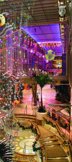Liven up your nights on the Navigator of the Seas. Stroll through the Royal Promenade for parades, dancing, and duty-free shopping.