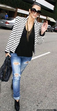 Kim Kardashian | Street Style: Strippey Jacket, boyfriend jeans and black shirt paired with a long necklace.