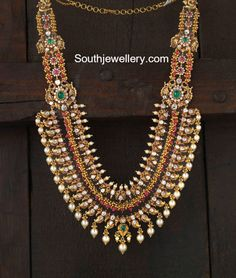 22 carat gold antique finish layered mango peacock nakshi haram adorned with polki diamonds, rubies, emeralds and south sea pearls by Navrathan Jewellers, Bangalore. Indian Jewellery Design, Latest Jewellery, Indian Jewelry, Jewelry Design, Pakistani Jewelry, Bespoke Jewellery, Bridal Jewelry, Gold Jewelry, Antique Jewelry