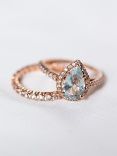 http://rubies.work/0015-rings/ Probably the only time I've actually loved a pear cut! I think it's the size and the aquamarine/colored stone.