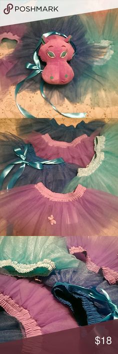 """Toddler tutu's. Size 2-3T. USA made Lets play dress up! Sweet toddler tutu. 2-3T. Waist measures 20"""" stretches to 24"""". Blue, turquoise, and purple. 1 blue has ribbon decor. 1 purple has butterfly decor. Hand made. USA. Bundle 2 or more save 20%. Hugs USA Costumes Dance"""