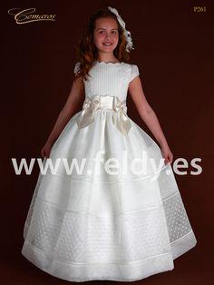 Vestido de Primera Comunión de niña. Falda de jaretas horizontales con una fila de vainicas en la parte inferior. Cuerpo de jaretas verticales.