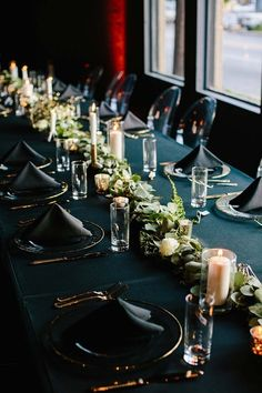 Black wedding tablescape decor  Atlanta wedding. Candles and greenery instead of florals.
