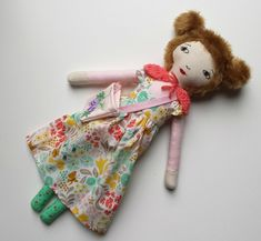This handmade, one of a kind, linen and cotton cloth doll is named Ria.She is approximately 46 cm (18 inches) tall. Her face has been carefully embroidered by hand.She is made from quality materials and made with lots of love and attention to detail.She wears a pretty floral dress with ruffles on her shoulders. She also wears a removable crochet cape and has a little pink shoulder bag.As her arms are secured with strong upholstery thread and buttons, she is not suitable...