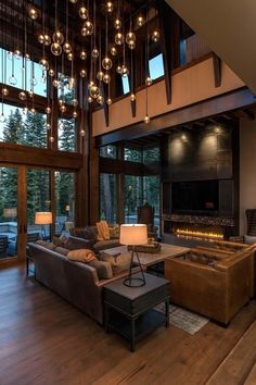 [866 x 1200] Living Room with two story tall windows and a cozy low fireplace