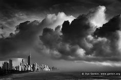 Storm Over Surfer's Paradise, Gold Coast, Queensland (QLD), Australia. Dramatic black and white photo of storm approaching Surfer's Paradise in the morning on Gold Coast, Queensland (QLD), Australia. Large clouds gather as though heralding the arrival of severe weather near Surfer's Paradise at the pacific coast of Queensland, Australia.