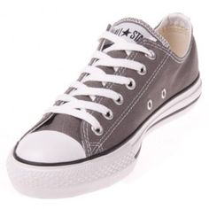 The Converse Chuck Taylor All Star Charcoal Low Top scores with this stylish canvas upper in dark grey, with the classic rubber outsole and vulcanized construction you expect from Converse.