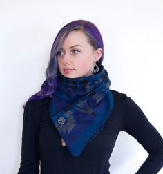 This is so classy! The snap scarf is great for people that like their scarves to stay in one place. No more messing with twisted scarves! This is the answer!  Blue Aztec Snap Scarf  Aztec acrylic fabric with Blue, black, and gray with extraordinarily soft Black polyester fabric lining hidden snaps that securely hold it closed and in place with marble button to finish it off!   This scarf is extremely comfortable!!  scarf is 60 long one size fits all