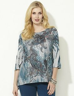 Stand out in the most captivating top of the season. Beautiful, flourishing paisleys create an allover, dream-like print. Comfortable, stretch fabric is silky to the touch for a polished look. Complete with three-quarter sleeves and an asymmetrical hem that falls longer on each side. Catherines tops are designed for the plus size woman to guarantee a flattering fit. catherines.com