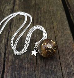 Gold leafs resin sphere  - resin - necklace by LykkeliDesign on Etsy https://www.etsy.com/listing/263612047/gold-leafs-resin-sphere-resin-necklace