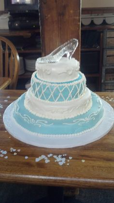 This is a Cinderella bridal shower cake. It fed 40 people. Yellow cake, vanilla butter cream, and covered in fondant