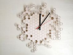 This wooden wall clock is the perfect gift for anyone that loves geometric shapes, beekeeping, laser cut designs or just someone you love! b...product.../b This clock is inspired by a honeycomb. The hexagonal cells are randomly placed and either filled or left empty. The side of the wood is black,...