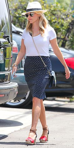 The Best Street Style Looks from Our Best Dressed Ladies | REESE WITHERSPOON | The star already shared her eight swear-by style rules, but we'll add a ninth: You can't go wrong shopping a collection you designed yourself (like her polka-dot skirt and print bag). Clear Westward Leaning sunglasses and cool sandals perfect the preppy look.