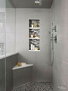 Small corner bench in a modern gray walk-in shower