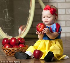 Mmmm, apples: Maddie (aka Snow White) examines a basket of red apples, hoping not to take a bite out of the poisoned one, while sitting in front of the magic mirror