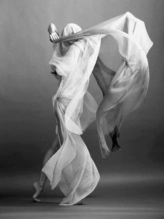 and she moved in fluent motion upon invisible winds..losing herself to the freedom that wove around her in a silken embrace..uncontained were her movements...as she became the wind itself..dancing upon it's breath.....