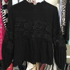 Black lace detailed long sleeved blouse Black material with lace detail on sleeves. Size medium but fits as a small. Only wore it once. Has button in back of neck. Tops Blouses