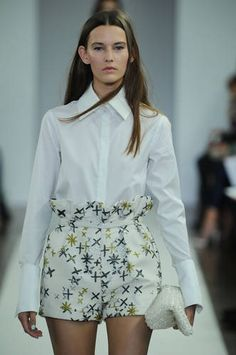 Crisp white shirts look fab with a pair of paper bag style high waist shorts as seen here at Osman #LFW #Inspiredby
