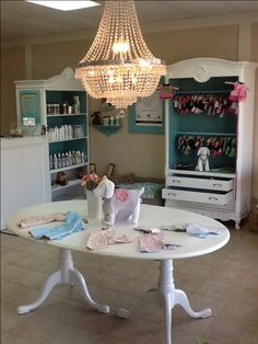 -repinned-Convert and re-purpose old armoires, tables, etc. to create that Shaggy Chic look for a dog grooming salon and boutique.  Don't forget a chandelier!