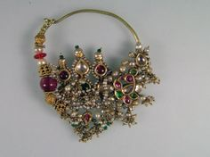 A nose ring from Southern Rajasthan, India. 18/19th century. Gold, Ruby, Emerald, Basra Pearls, Diamonds, Glass. About 6,5 x 8,0 cm. Posted by Michael Beste.