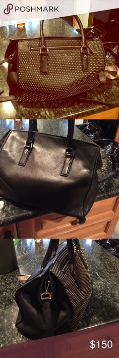 Micheal Kores Black studed purse Pretty large purse with lots of room. All black with silver studs in the front. Has an on/off handle that you can carry it. Plenty of storage and a zip in front. Was limited addition! Michael Kors Bags Totes