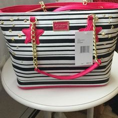 Betsey Johnson star studded stripe tote Pink,black and white stripes. Pink and gold straps. It has studded stares and is black and white stripe. It will stand out wherever you go! Betsey Johnson Bags Totes