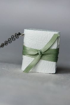 Items similar to Custom Made Book Necklace- White leather, Light Green ribbon on Etsy Book Necklace, Green Ribbon, White Leather, Custom Made, Amy, Necklaces, Trending Outfits, Unique Jewelry, Handmade Gifts