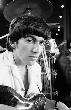 Close-up of George Harrison on set.
