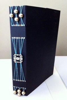 I'd like to try using old jewelry like this. #bookbinding #bookarts #longstitch