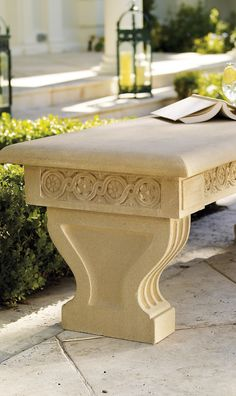 The Hawthorne Bench from Barbara Israel provides elegant seating for the garden. Made from the finest composition stone, this bench is skillfully reproduced from a 1915 Philadelphia-made terracotta original.