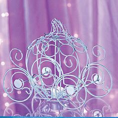Place these Fairytale Dreams Centerpieces on your tables and watch your fairytale event unfold. Each metal Fairytale Dreams Centerpiece is 9 inches high x 6 inches wide x 10 inches long. Candle is sold separately.