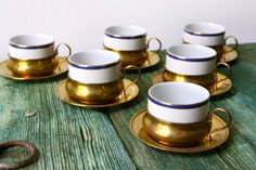Set of six tea cups in brass holders by rusticitalia on Etsy, £55.00