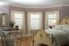 Sheer drapery gives the windows a soft look.