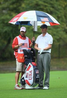 Webb Simpson of the U.S. Team and his caddie Paul Tesori wait to hit his second shot on the second hole during the Day Four Singles Matches at the Muirfield Village Golf Club on October 6, 2013  in Dublin, Ohio.