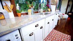 White kitchen cabinets and light granite countertop - Vintage by Tiny Heirloom