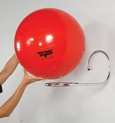 Exercise Ball Storage: When you're working with limited space, every inch is crucial. Make your corners more efficient with a couple shelves and a DIY exercise ball storage solution using a bungee cord and nails. (via TrifDecor) Basement Gym, Garage Gym, Attic Renovation, Attic Remodel, Home Gym Equipment, No Equipment Workout, Fitness Equipment, Cycling Equipment, Ball Storage