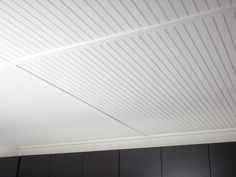 Painted bead board for basement ceiling.